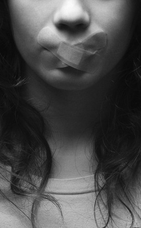 restraints: Woman with bandage over mouth