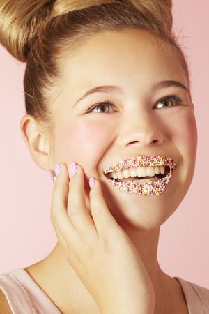 pubescent: Teenage girl wearing colorful lipstick