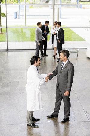 gather: Business people and doctors greeting