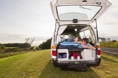 adventuresome: Couple under comforter in trailer