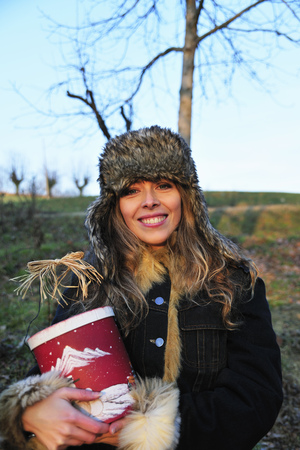 posed: Woman wearing fur hat outdoors