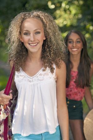 Teenage girls walking on rural road