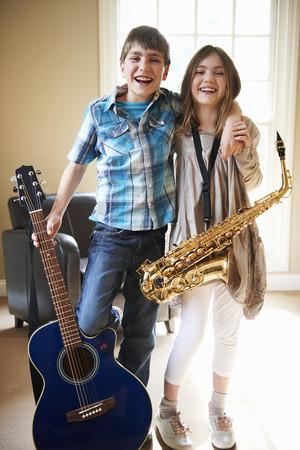 Children holding musical instruments
