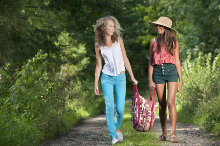 Teenage girls walking on rural road