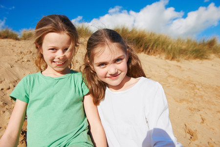 Two girls on beach,portrait