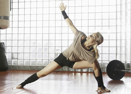arms lifted up: Woman practicing yoga in gym LANG_EVOIMAGES