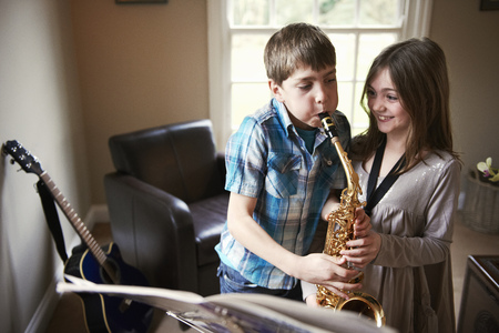 musically: Children playing with saxophone
