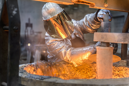 retiring: Workers cleaning metal flask in factory LANG_EVOIMAGES