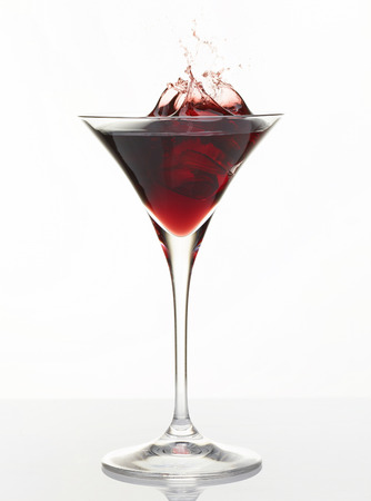 refreshed: Cocktail splashing in glass