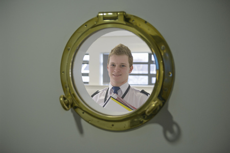 proudly: Student looking through ships porthole LANG_EVOIMAGES