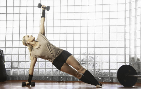elongation: Woman working out in gym