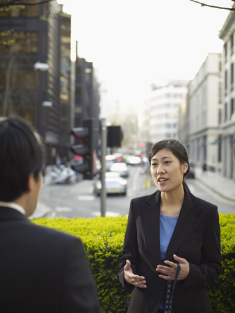 communicated: Business people talking on city street