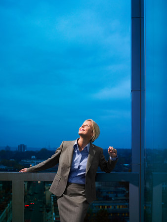 towerblock: Smart lady in corporate environment overlooking the city LANG_EVOIMAGES