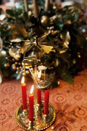 Candles burning on Christmas decoration