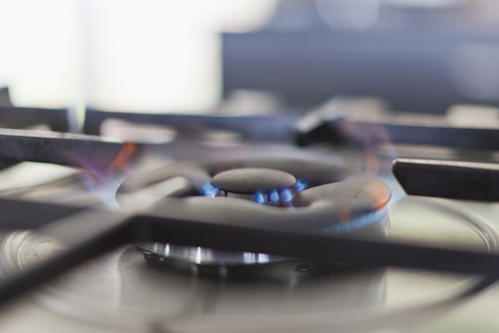 heats: Close up of gas burner with flame LANG_EVOIMAGES