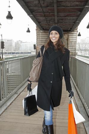 shopper: Woman carrying shopping bags on platform