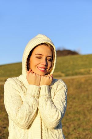 'eyes shut: Woman smiling in rural field