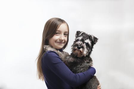 omnivore: Smiling girl holding dog