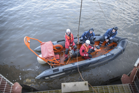 Rescue boat training by ship