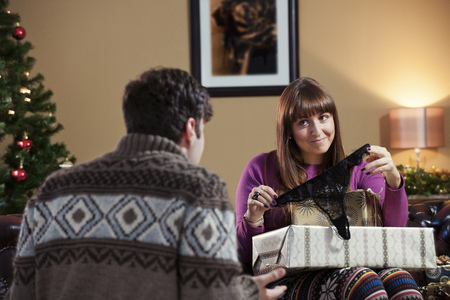 interrogations: Couple opening Christmas presents