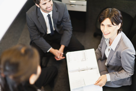 Business people talking in office LANG_EVOIMAGES