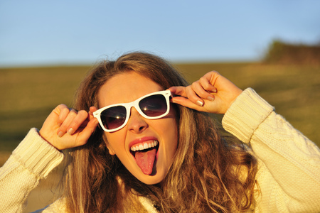 Woman in sunglasses in rural field