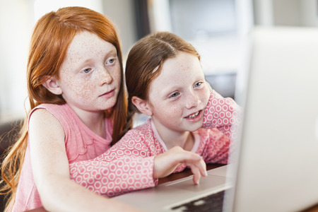 shared sharing: Girls using laptop together