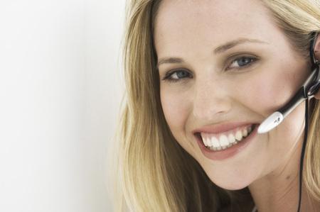 handsfree telephones: Smiling businesswoman wearing headset