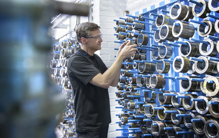 resolving: Worker selecting metal coil in factory LANG_EVOIMAGES