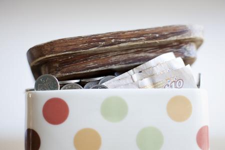 Jar full of money on desk LANG_EVOIMAGES