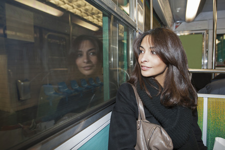 motorcoach: Smiling woman riding subway