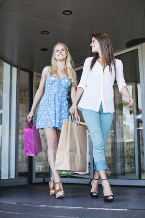 shopper: Women shopping together on city street