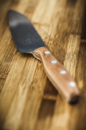 usefulness: Close up of knife on wooden table LANG_EVOIMAGES