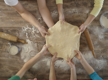 preadolescent: Overhead view of people making bread