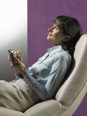 booked: Businesswoman using cell phone