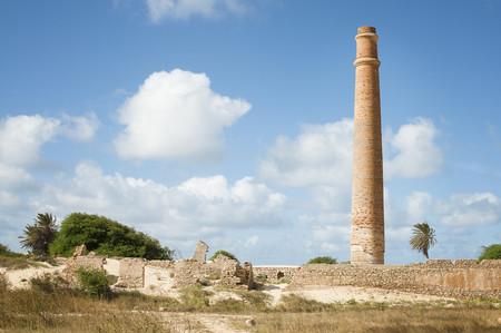 smokestack: Smokestack over stone ruins LANG_EVOIMAGES