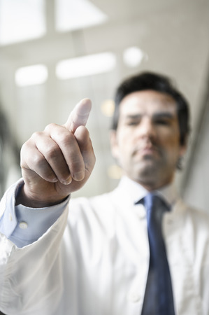 appendage: Close up of doctor touching glass panel