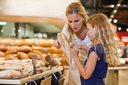 in twos: Mother and daughter in grocery store