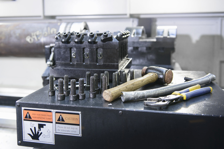 Nuts and bolts on industrial lathe