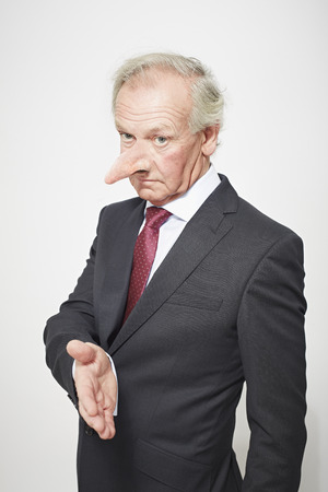 agrees: Businessman with long nose offering hand
