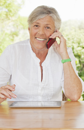 silver surfer: Older woman talking on cell phone