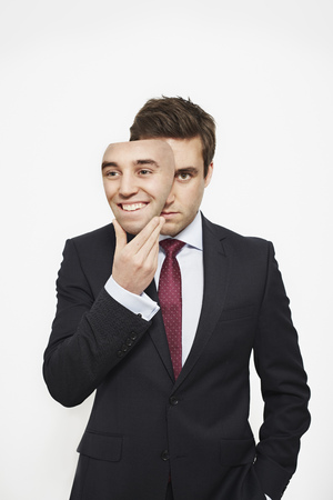 bashfulness: Businessman holding mask over his face