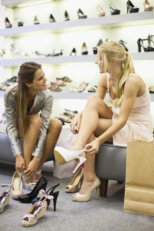 shopper: Women shopping for shoes together