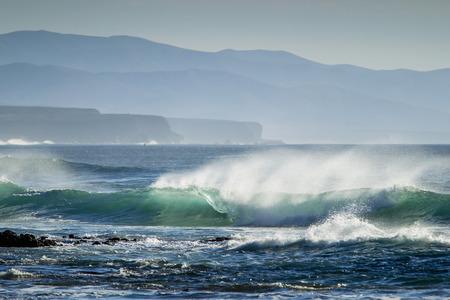 Waves crashing on beach LANG_EVOIMAGES