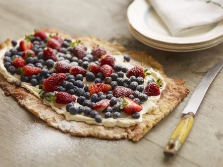 tempted: Close up of fruit and cream tart LANG_EVOIMAGES