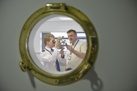 Student and teacher using sextant