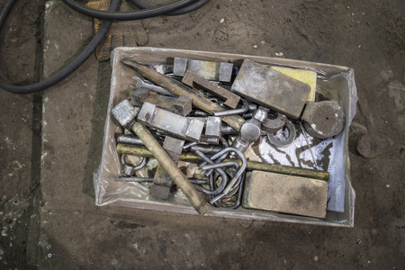 odds: Box of tools in metal foundry