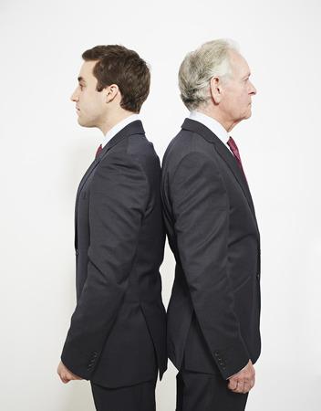 equivalents: Businessmen standing back to back