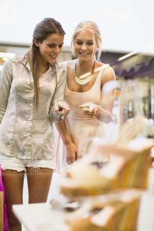 browses: Women window shopping together