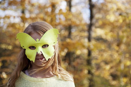 dressups: Girl wearing butterfly mask in park